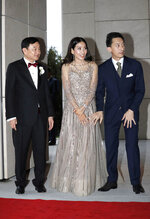 From left, former Thai Prime Minister Thaksin Shinawatra, his daughter Pintongtha