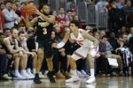 Purdue's Jahaad Proctor, left, looks for an open pass as Ohio State's Duane Washington defends during the second half of an NCAA college basketball game Saturday, Feb. 15, 2020, in Columbus, Ohio. Ohio State beat Purdue 68-52. (AP Photo/Jay LaPrete)