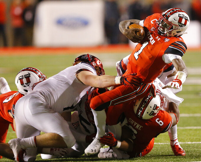 Arizona linebacker Colin Schooler, left, tackles Utah quarterback Tyler Huntley (1) during the first half of an NCAA college football game Friday, Oct. 12, 2018, in Salt Lake City. (AP Photo/Rick Bowmer)