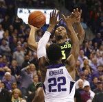 Baylor guard King McClure (3) tries to score over TCU guard RJ Nembhard (22) in the second half of an NCAA college basketball game, Saturday, Jan. 5, 2019, in Fort Worth, Texas. (Rod Aydelotte/Waco Tribune Herald, via AP)