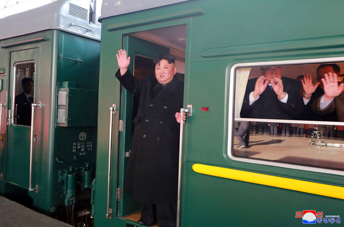 In this Saturday, Feb. 23, 2019, photo provided on Sunday, Feb. 24, 2019, by the North Korean government, North Korean leader Kim Jong Un waves from a train before leaving Pyongyang Station, North Korea, for Vietnam. Kim was on a train Sunday to Vietnam for his second summit with U.S. President Donald Trump, state media confirmed. Independent journalists were not given access to cover the event depicted in this image distributed by the North Korean government. The content of this image is as provided and cannot be independently verified. Korean language watermark on image as provided by source reads: