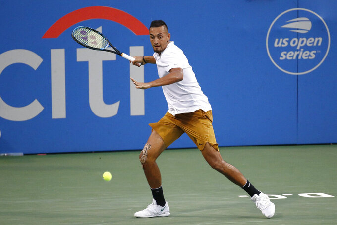 "FILE - In this Saturday, Aug. 3, 2019, file photo, Nick Kyrgios, of Australia, returns the ball to Stefanos Tsitsipas, of Greece, during a semifinal at the Citi Open tennis tournament in Washington. The tournament that was supposed to mark the official return of men's professional tennis amid the coronavirus pandemic has been canceled. The Citi Open in Washington, scheduled to start with Aug. 13 qualifying, was called off Tuesday, July 21, 2020, because of what tournament manager Mark Ein said are ""too many unresolved external issues, including various international travel restrictions as well as troubling health and safety trends.""(AP Photo/Patrick Semansky, File)"