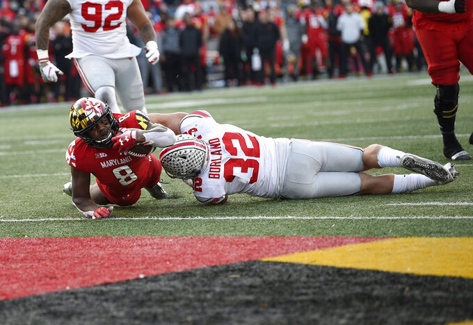 Maryland running back Talon Fleet-Davis (8) dives for a touchdown during overtime of an NCAA football game against Ohio State linebacker Tuf Borland (32), Saturday, Nov. 17, 2018, in College Park, Md. Ohio State won 52-51 in overtime. (AP Photo/Nick Wass)