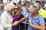 Camilla, Duchess of Cornwall, left, greets members of the public during a walk at Viaduct Harbour in Auckland during their royal visit to New Zealand, Tuesday, Nov. 19, 2019. The visit is part of a week-long tour of the country which also takes in Christchurch and Kaikoura. (David Rowland/Pool Photo via AP)