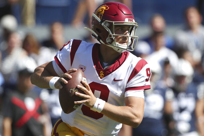 FILE - In this Sept. 14, 2019, file photo, quarterback Kedon Slovis looks to pass the ball during the second half against BYU in an NCAA college football game in Provo, Utah. Slovis will return from injury to start for Southern California at No. 9 Notre Dame on Saturday night. USC coach Clay Helton made the announcement Tuesday night, Oct. 8, after practice. (AP Photo/George Frey, File)