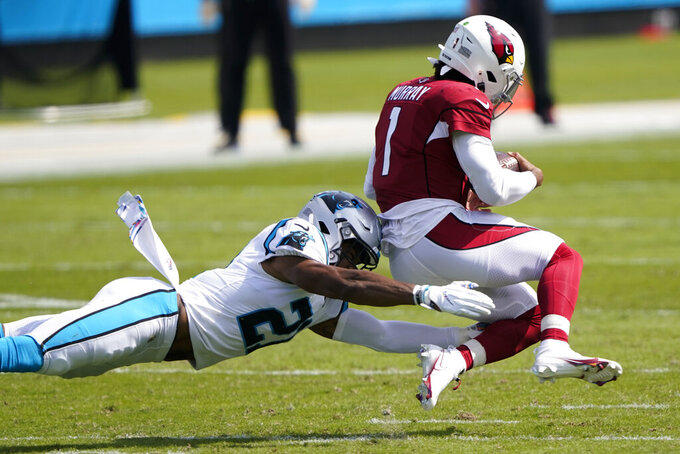 Arizona Cardinals quarterback Kyler Murray is tackled by Carolina Panthers outside linebacker Jeremy Chinn during the first half of an NFL football game Sunday, Oct. 4, 2020, in Charlotte, N.C. (AP Photo/Brian Blanco)
