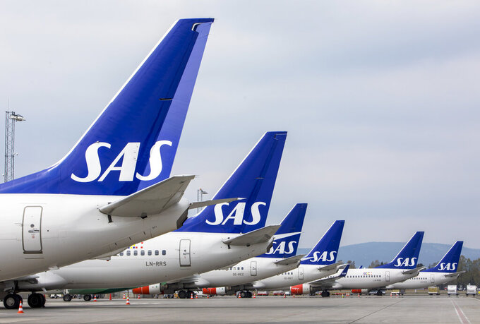 FILE - In this Friday, April 26, 2019 file photo, SAS planes are grounded at Oslo Gardermoen airport during pilots strikes, in Oslo. Scandinavian Airlines said Tuesday June 30, 2020, it is getting an aid package worth 14.25 billion kronor ($1.5 billion) after an agreement with its main shareholders, securing the carrier's survival amid the COVID-19 crisis. (Ole Berg-Rusten/NTB Scanpix via AP, File)