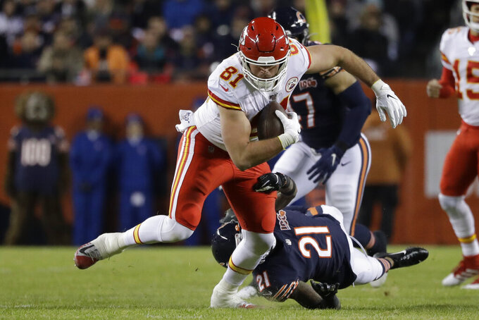 Kansas City Chiefs tight end Blake Bell (81) breaks the tackle of Chicago Bears strong safety Ha Ha Clinton-Dix (21) in the first half of an NFL football game in Chicago, Sunday, Dec. 22, 2019. (AP Photo/Nam Y. Huh)