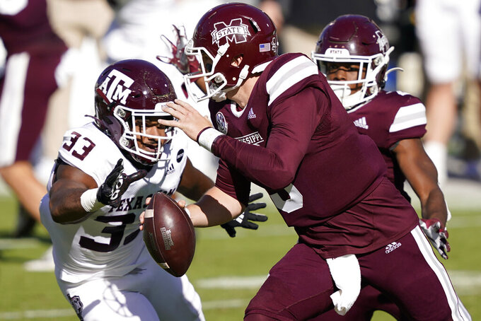 Texas A&M linebacker Aaron Hansford (33) closes in to sack Mississippi State quarterback K.J. Costello (3) during the second quarter of an NCAA college football game in Starkville, Miss., Saturday, Oct. 17, 2020. (AP Photo/Rogelio V. Solis)