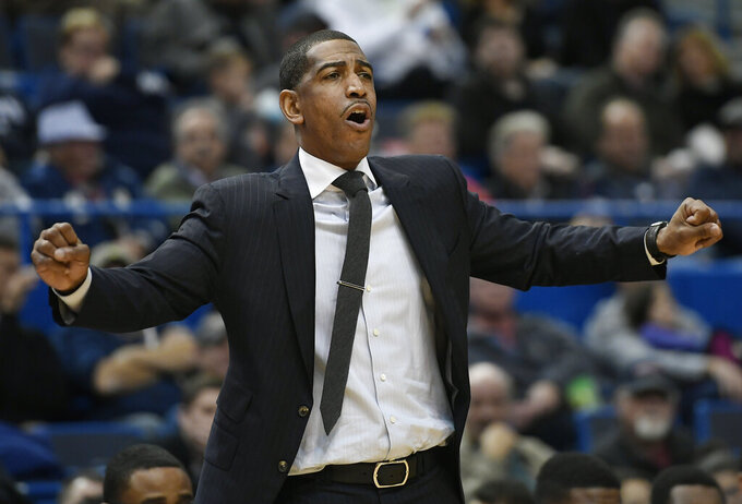FILE - Connecticut head coach Kevin Ollie calls out to his team during the second half of an NCAA college basketball game against Stony Brook in Hartford, Conn., in this Tuesday, Nov. 14, 2017, file photo. A new basketball league for elite high school players is building a state-of-the-art facility in Atlanta. Overtime Elite announced Wednesday, May 19, 2021, it's constructing a 103,000-square-foot complex where players will train, study and compete. Last month, the league hired a head coach in Kevin Ollie, who led Connecticut to a national title in 2014. (AP Photo/Jessica Hill, File)