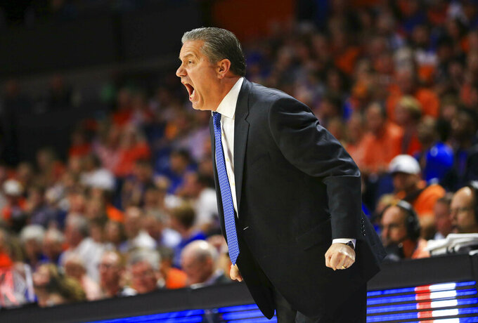 Kentucky head coach John Calipari yells to his team during the second half of an NCAA college basketball game against Florida, Saturday, Feb. 2, 2019, in Gainesville, Fla. (AP Photo/Matt Stamey)