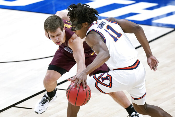 Loyola of Chicago's Braden Norris, left, defends against Illinois' Ayo Dosunmu (11) during the first half of a college basketball game in the second round of the NCAA tournament at Bankers Life Fieldhouse in Indianapolis Sunday, March 21, 2021. (AP Photo/Mark Humphrey)