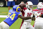 Arizona Cardinals quarterback Chris Streveler (15) fumbles the ball as he is hit by Los Angeles Rams outside linebacker Leonard Floyd (54) during the first half of an NFL football game in Inglewood, Calif., Sunday, Jan. 3, 2021. The Cardinals recovered the ball. (AP Photo/Jae C. Hong)