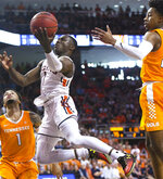 Auburn guard Jared Harper (1) drives through Tennessee defense to score two points during the second half of an NCAA college basketball game Saturday, March 9, 2019, in Auburn, Ala. (AP Photo/Julie Bennett)