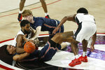 Samford guard Christian Guess, bottom, and Jaron Rillie compete with Georgia's Andrew Garcia for possession of the ball during an NCAA college basketball game in Athens, Ga., Saturday, Dec. 12, 2020. (Joshua L. Jones/Athens Banner-Herald via AP)