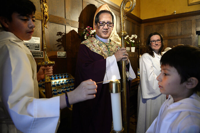 FILE - In this March 4, 2018, file photo, Catholic Bishop Oscar A. Solis waits in an anteroom prior to leading the Mass on the third Sunday of Lent in Salt Lake City. Prompted by the recent scandal surrounding sexual abuse by Catholic priests across Pennsylvania, the bishop of the Salt Lake City diocese is publicly disclosing Utah's own history of