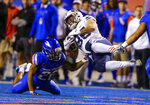 BYU running back Brayden El-Bakri (35) is spun to the ground after being hit by Boise State cornerback Avery Williams (26) during the first half of an NCAA college football game Saturday, Nov. 3, 2018, in Boise, Idaho. (AP Photo/Steve Conner)