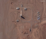 This Feb. 4, 2020 satellite image from Maxar Technologies, shows preparations at a rocket launch pad at the Imam Khomeini Space Center in Iran's Semnan province. An Iranian rocket failed to put a satellite into orbit on Sunday, Feb. 9, 2020, state television reported, the latest setback for a program the U.S. claims helps Tehran advance its ballistic missile program. (Maxar Technologies via AP)