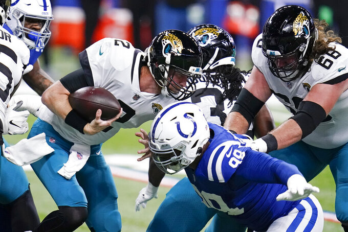 Jacksonville Jaguars quarterback Mike Glennon (2) is sacked by Indianapolis Colts' DeForest Buckner (99) during the first half of an NFL football game, Sunday, Jan. 3, 2021, in Indianapolis. (AP Photo/Michael Conroy)