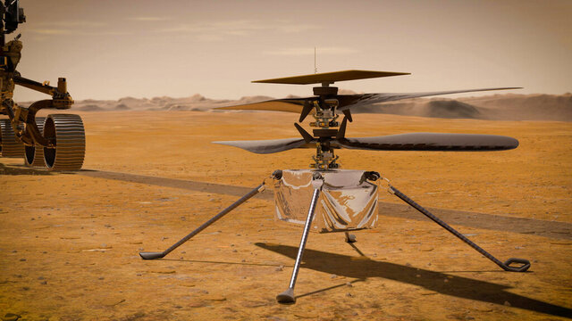 This illustration made available by NASA depicts the Ingenuity Mars Helicopter on the red planet's surface near the Perseverance rover, left. NASA is upping the ante with its newest rover headed to Mars. Set to rocket away this week from Florida, Perseverance is NASA's brawniest and brainiest Martian rover yet.  (NASA/JPL-Caltech via AP)