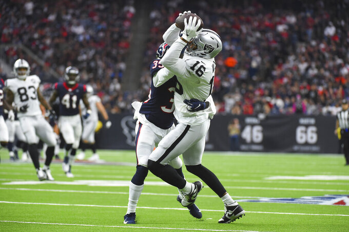 Oakland Raiders wide receiver Tyrell Williams (16) is hit by Houston Texans defensive back Keion Crossen (35) after a catch during the second half of an NFL football game Sunday, Oct. 27, 2019, in Houston. (AP Photo/Eric Christian Smith)