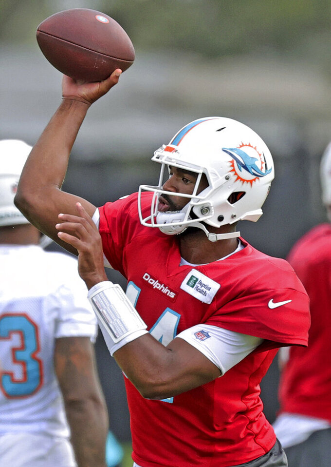 Miami Dolphins quarterback Jacoby Brissett (14) throws during NFL football practice at Baptist Health Training Complex in Hard Rock Stadium on Thursday, Oct. 7, 2021, in Miami Gardens, Fla. The Dolphins play the Tampa Bay Buccaneers on Sunday in Tampa.  (David Santiago/Miami Herald via AP)