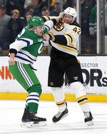 Carolina Hurricanes left wing Micheal Ferland (79) and Boston Bruins right wing David Backes (42) fight during the first period of an NHL hockey game, Tuesday, March 5, 2019, in Boston. (AP Photo/Mary Schwalm)