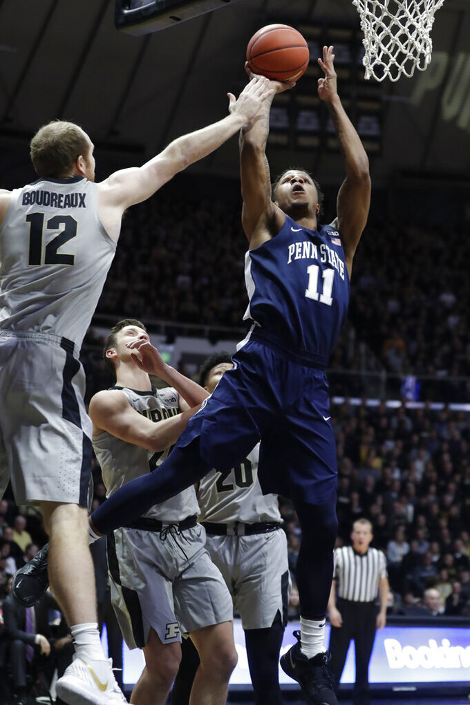 Penn State forward Lamar Stevens (11) shoots over Purdue forward Evan Boudreaux (12) during the first half of an NCAA college basketball game in West Lafayette, Ind., Saturday, Feb. 16, 2019. (AP Photo/Michael Conroy)