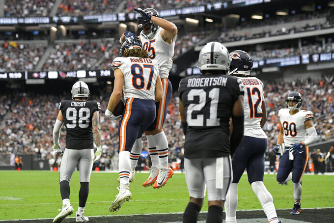 Chicago Bears tight end Cole Kmet (85) celebrates after tight end Jesper Horsted (87) scored a touchdown against the Las Vegas Raiders during the first half of an NFL football game, Sunday, Oct. 10, 2021, in Las Vegas. (AP Photo/David Becker)