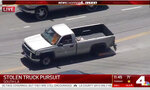 In this Friday May 22, 2020, photo from video provided by KNBC-TV a pickup truck that had been reported stolen is pursued by police on Southern California streets and freeways. Two people were taken into custody after the pursuit ended in South Los Angeles. The coronavirus hasn't been kind to car owners. With more people than ever staying home to lessen the spread of COVID-19, their sedans, pickup trucks and SUVs are parked unattended on the streets, making them easy targets for opportunistic thieves.  (KNBC-TV via AP)