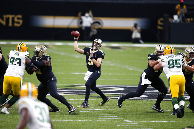 New Orleans Saints quarterback Drew Brees (9) passes under pressure from Green Bay Packers defensive end Billy Winn (93) and nose tackle Tyler Lancaster (95) in the first half of an NFL football game in New Orleans, Sunday, Sept. 27, 2020. (AP Photo/Butch Dill)