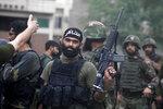 An Armed Pakistani commando wears headband reads