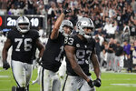 Las Vegas Raiders tight end Darren Waller (83) celebrates after scoring a touchdown against the Baltimore Ravens during the second half of an NFL football game, Monday, Sept. 13, 2021, in Las Vegas. (AP Photo/Rick Scuteri)
