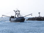In this Sept. 11, 2019 photo, the commercial fishing boat Ann Kathryn sails into the Manasquan Inlet in Manasquan, N.J. Although they support effortsto fight climate change and its impact on the world's oceans, the fishing industry fears it could be harmed by one of the promising solutions: the offshore wind energy industry. At a Congressional subcommittee hearing Monday Sept. 16, 2019 in New Jersey, fishermen asked for a seat at the table when important wind energy decisions are made, including where projects are located. (AP Photo/Wayne Parry)