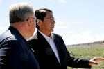 FILE - In this May 28, 2019, file photo, Navajo Nation President Jonathan Nez, right, and U.S. Interior Secretary David Bernhardt look out over Pueblo Bonito, at Chaco Culture National Historical Park, N.M. Lawmakers from the country's largest American Indian reservation may have thrown a wrinkle into efforts aimed at establishing a permanent buffer around the national park. Navajo Nation delegates voted Thursday, Jan. 23, 2020, to support a buffer only half the size of the one proposed in legislation pending in Congress. The Navajo vote comes despite support from the pueblos, Navajo President Nez and some individual Navajo communities for the more expansive protective zone. (Hannah Grover/The Daily Times via AP, File)