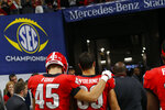 FILE - In this Dec. 1, 2018 file photo Georgia tight end Luke Ford (45) and Georgia tight end Charlie Woerner (89) head to the locker room after losing to Alabama in the Southeastern Conference Championship game in Atlanta. A year ago, Georgia was getting ready for the College Football Playoff. The team missed out on the four-team playoff field after another bitter loss to Alabama, forcing it to settle for the Sugar Bowl as a consolation prize. (Joshua L. Jones/Athens Banner-Herald via AP, file)
