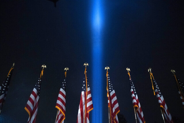 A beam of light is seen over the Pentagon, as part of the Towers of Light Tribute marking the 19th anniversary of the 9/11 attack on the Pentagon, Wednesday, Sept. 9, 2020, in Washington. (AP Photo/Jose Luis Magana)