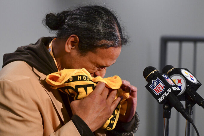 Former Pittsburgh Steelers safety and recent Pro Football Hall Of Fame inductee Troy Polamalu reacts as he speaks at a news conference before an NFL football game between the Steelers and the Seattle Seahawks, Sunday, Oct. 17, 2021, in Pittsburgh. (AP Photo/Fred Vuich)