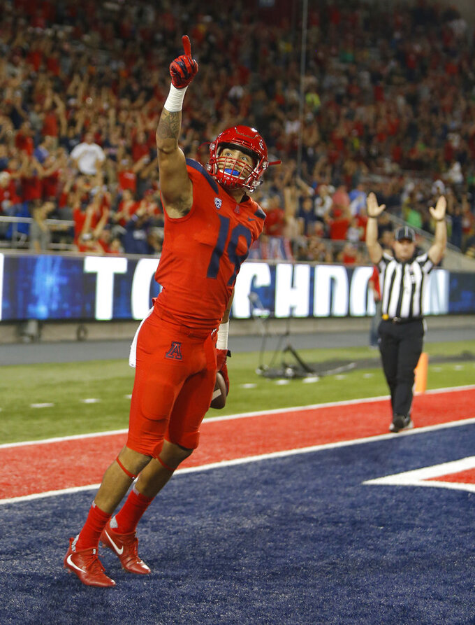 Arizona wide receiver Shawn Poindexter celebrates after scoring a touchdown in the first half during an NCAA college football game against Oregon, Saturday, Oct. 27, 2018, in Tucson, Ariz. (AP Photo/Rick Scuteri)