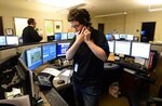 Megan Whitby, shift commander at the Erie County 911 Center in Summit Township, Pa., takes a phone call on April 4. ( Jack Hanrahan/Erie Times-News via AP)