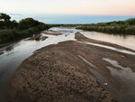 FILE - In this Oct. 10, 2018, file photo, sandbars form in the Rio Grande channel as the river flows on the northern edge of Albuquerque, N.M. New Mexico lawmakers are considering setting aside $20 million that could be used as seed money as water managers in the arid state scramble to find ways to reduce groundwater pumping that is at the center of a legal battle over one of North America's longest rivers. The ongoing fight over the Rio Grande has pitted Texas and New Mexico against one another before the U.S. Supreme Court. (AP Photo/Susan Montoya Bryan, File)