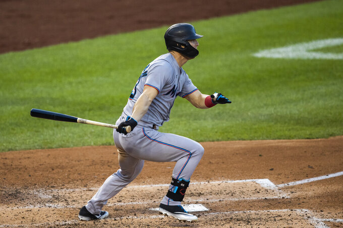 Miami Marlins Corey Dickerson hits a one-run single during the fourth inning of a baseball game against the Washington Nationals in Washington, Monday, Aug. 24, 2020. (AP Photo/Manuel Balce Ceneta)