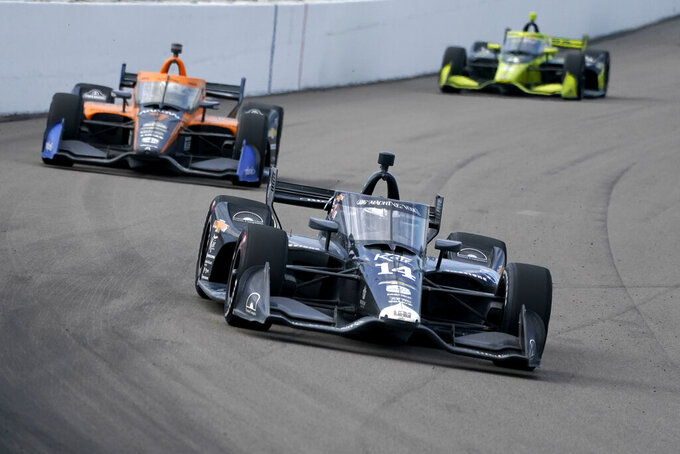 Tony Kanaan (14) drives into Turn 1 followed by Oliver Askew (7) and Charlie Kimball (4) during the IndyCar auto race at World Wide Technology Raceway on Sunday, Aug. 30, 2020, in Madison, Ill. (AP Photo/Jeff Roberson)
