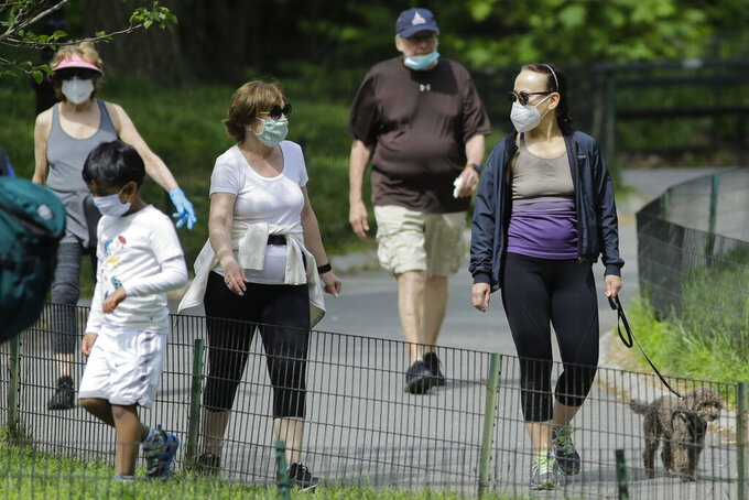 People wearing protective masks enter Central park during the coronavirus pandemic Saturday, May 16, 2020, in New York. (AP Photo/Frank Franklin II)