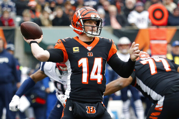 FILE - In this Dec. 15, 2019, file photo, Cincinnati Bengals quarterback Andy Dalton (14) passes in the first half of an NFL football game against the New England Patriots in Cincinnati. Dalton is coming home to Texas as Dak Prescott's backup with the Dallas Cowboys. Dalton and the Cowboys agreed to a one-year deal that guarantees the former Cincinnati starter $3 million and could be worth up to $7 million, two people with direct knowledge of the deal told The Associated Press on Saturday, May 2, 2020. (AP Photo/Frank Victores, File)