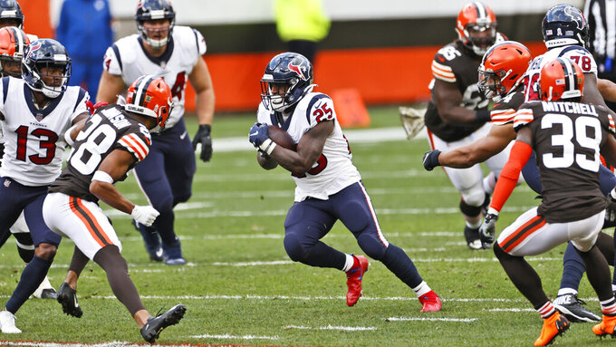 Houston Texans running back Duke Johnson (25) rushes during the first half of an NFL football game against the Cleveland Browns, Sunday, Nov. 15, 2020, in Cleveland. (AP Photo/Ron Schwane)