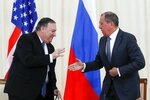 U.S. Secretary of State Mike Pompeo, left, and Russian Foreign Minister Sergey Lavrov shake hands after their joint news conference following the talks in the Black Sea resort city of Sochi, southern Russia, Tuesday, May 14, 2019. Pompeo's first trip to Russia starts Tuesday in Sochi, where he and Russian Foreign Minister Sergey Lavrov are sitting down for talks and then having a joint meeting with President Vladimir Putin. (AP Photo/Pavel Golovkin, Pool)