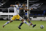 Minnesota United forward Luis Amarilla, right, scores past San Jose Earthquakes defender Oswaldo Alanis during the second half of an MLS soccer match, Saturday, Aug. 1, 2020, in Kissimmee, Fla. (AP Photo/John Raoux)