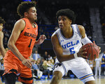 UCLA guard Chris Smith, right, drives to the basket while Oregon State guard Stephen Thompson Jr. defends during the second half of an NCAA college basketball game in Los Angeles, Thursday, Feb. 21, 2019. UCLA won 68-67. (AP Photo/Kelvin Kuo)