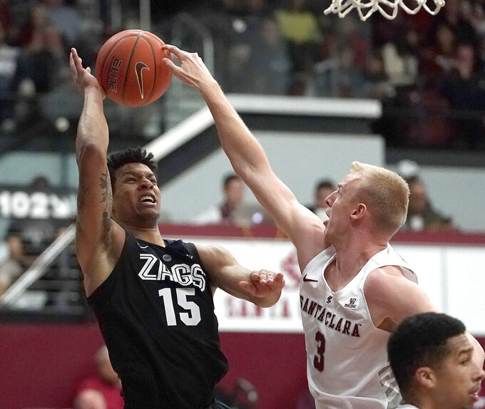 Santa Clara forward Henrik Jadersten (3) blocks a shot by Gonzaga forward Brandon Clarke (15) during the first half of an NCAA college basketball game Thursday, Jan. 24, 2019, in Santa Clara, Calif. (AP Photo/Tony Avelar)